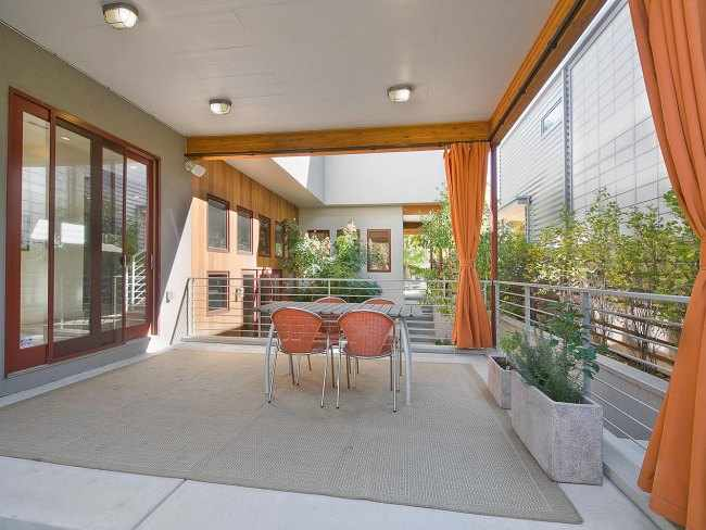 Ideas para decorar terrazas peque as for Pisos de terrazas